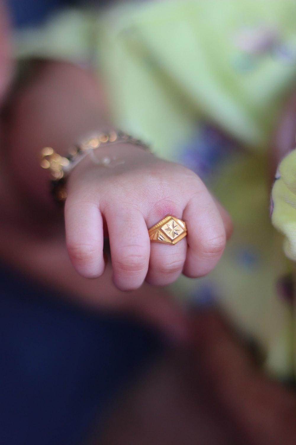 gold diamond ring on persons finger