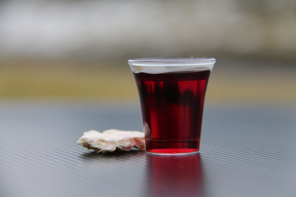 clear drinking glass with red liquid