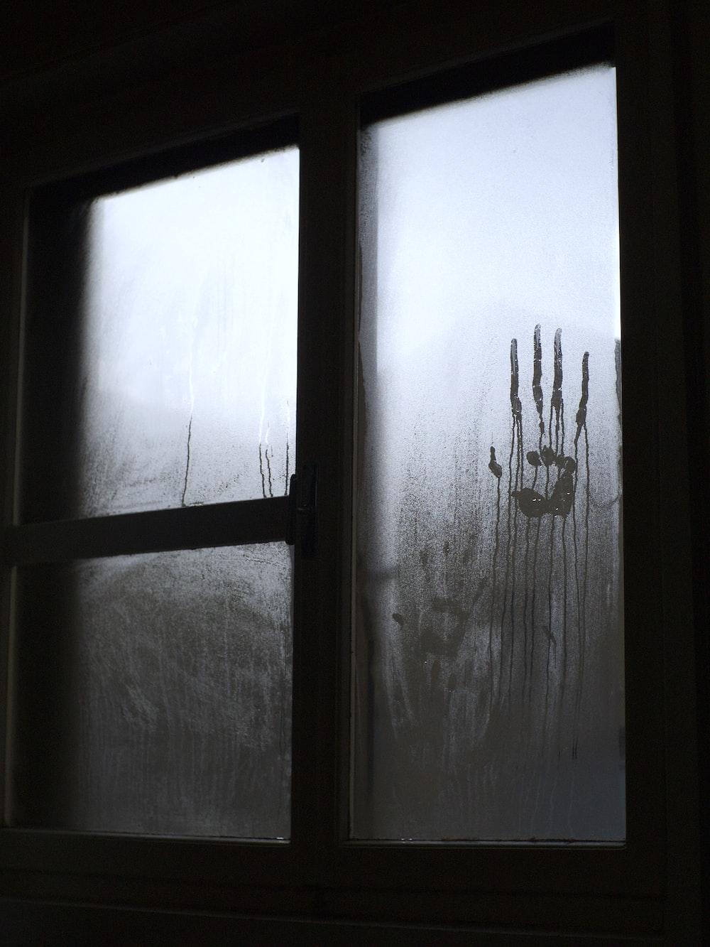 black wooden framed glass window