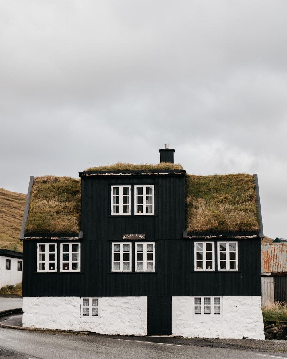 black and white house under white sky during daytime