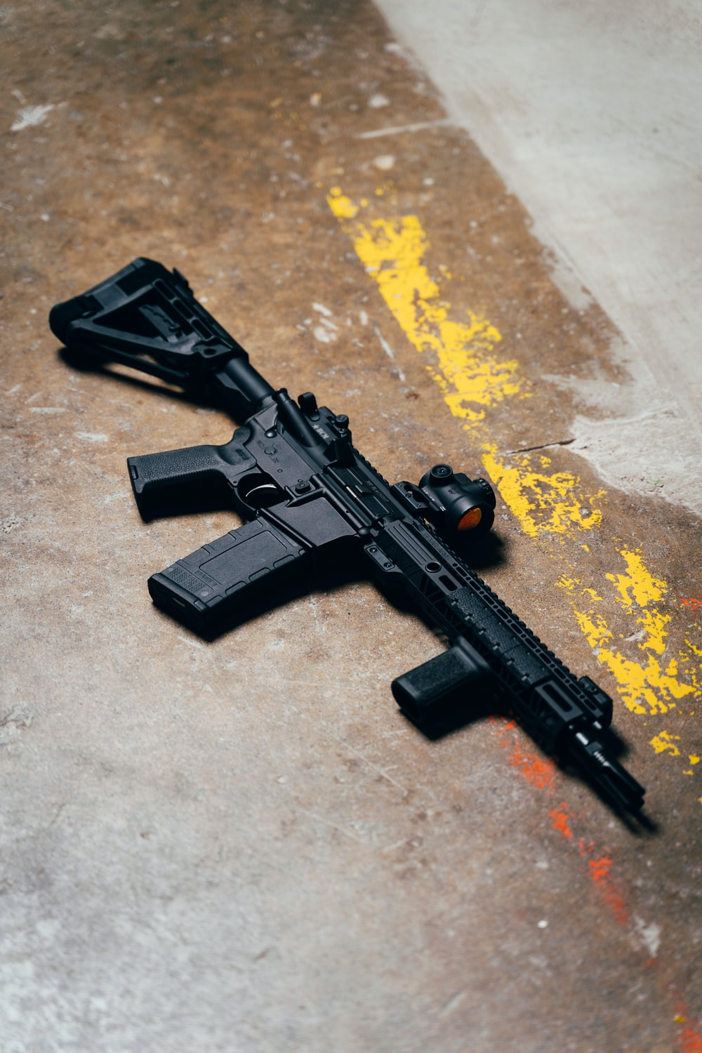 black rifle on brown and yellow surface