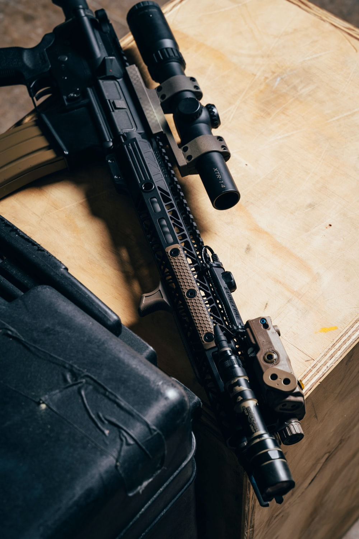 black rifle on white textile
