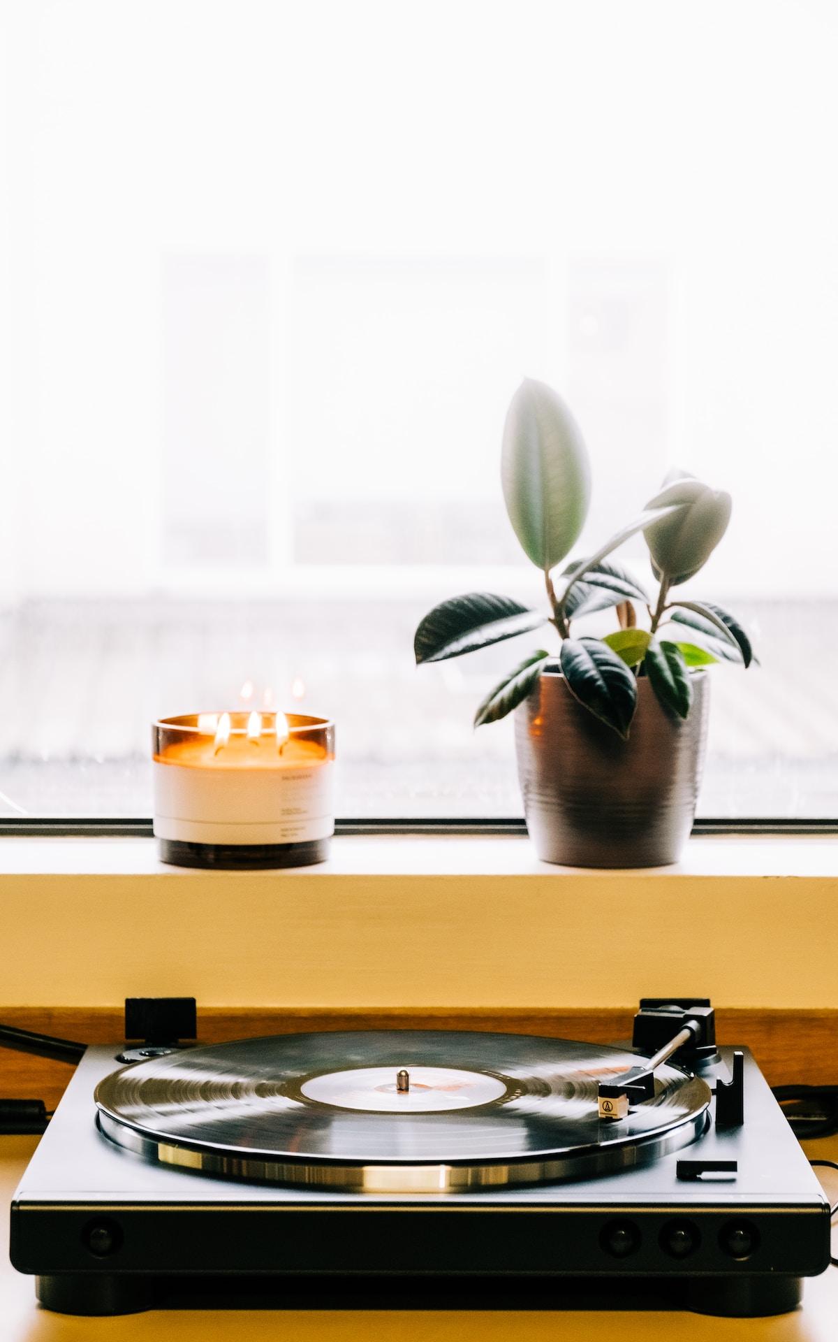white candle on white ceramic holder