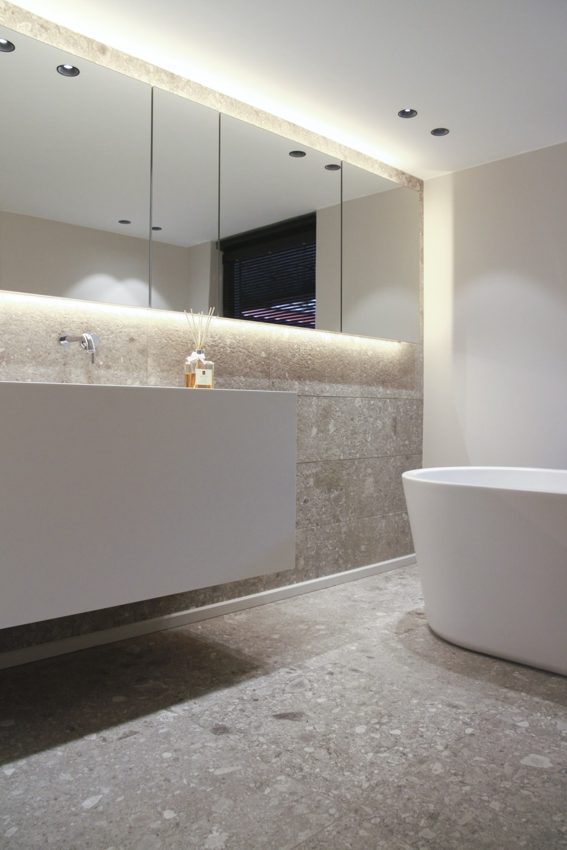 white bathtub near white bathtub