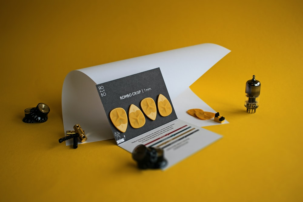 white printer paper on yellow table