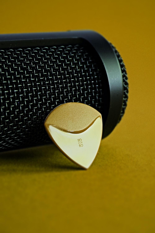 black and white speaker on yellow textile