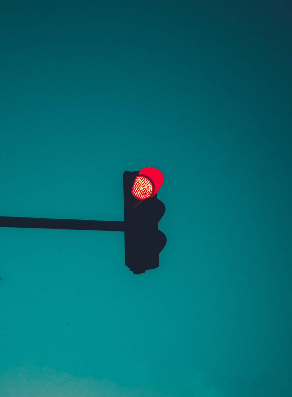 red stop light on green background