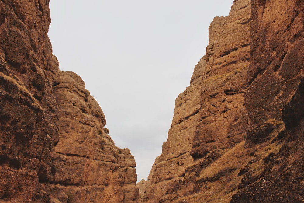 brown rock formation under white sky during daytime