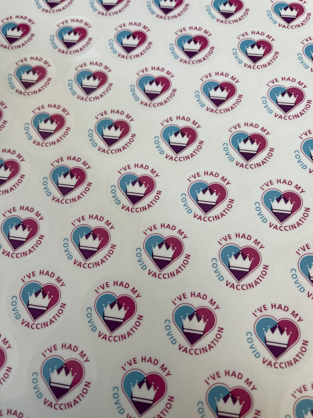 white blue and red heart and star print textile