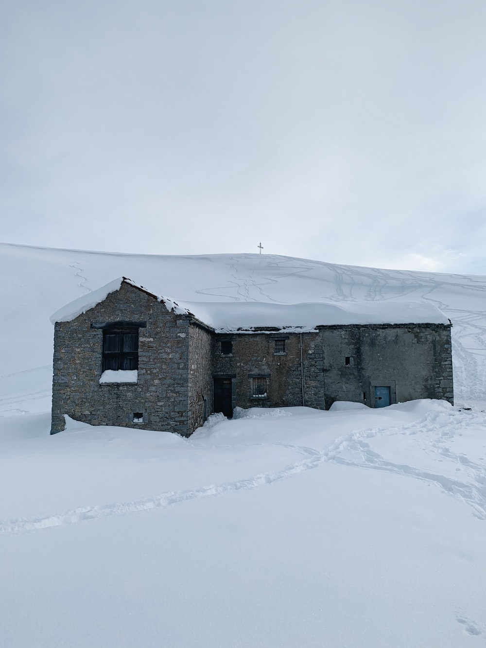 gray concrete house on snow covered ground