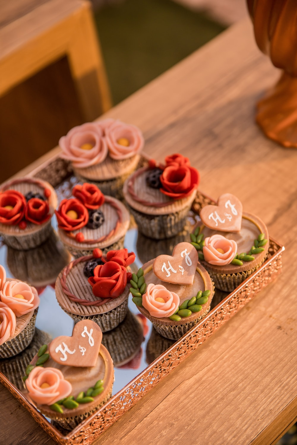 cupcakes on brown wooden tray