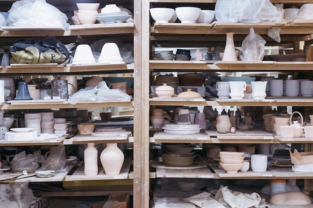 white ceramic teacup on brown wooden shelf