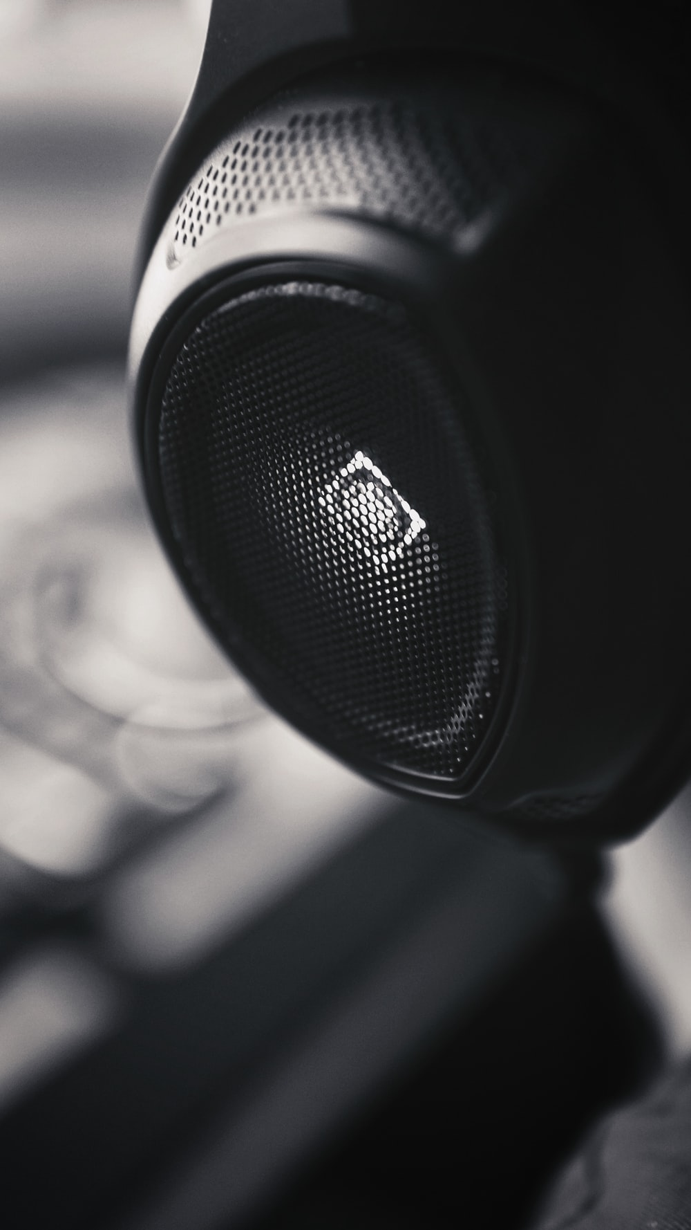 black and silver speaker in grayscale photography