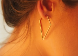 woman with gold hoop earrings