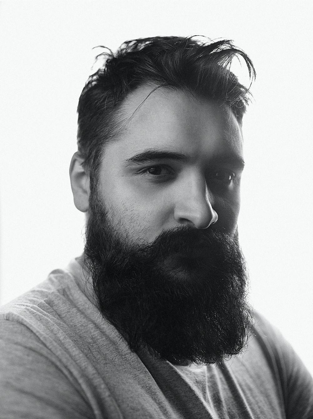 man in gray shirt with black beard