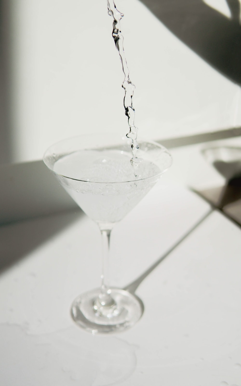clear cocktail glass on white table