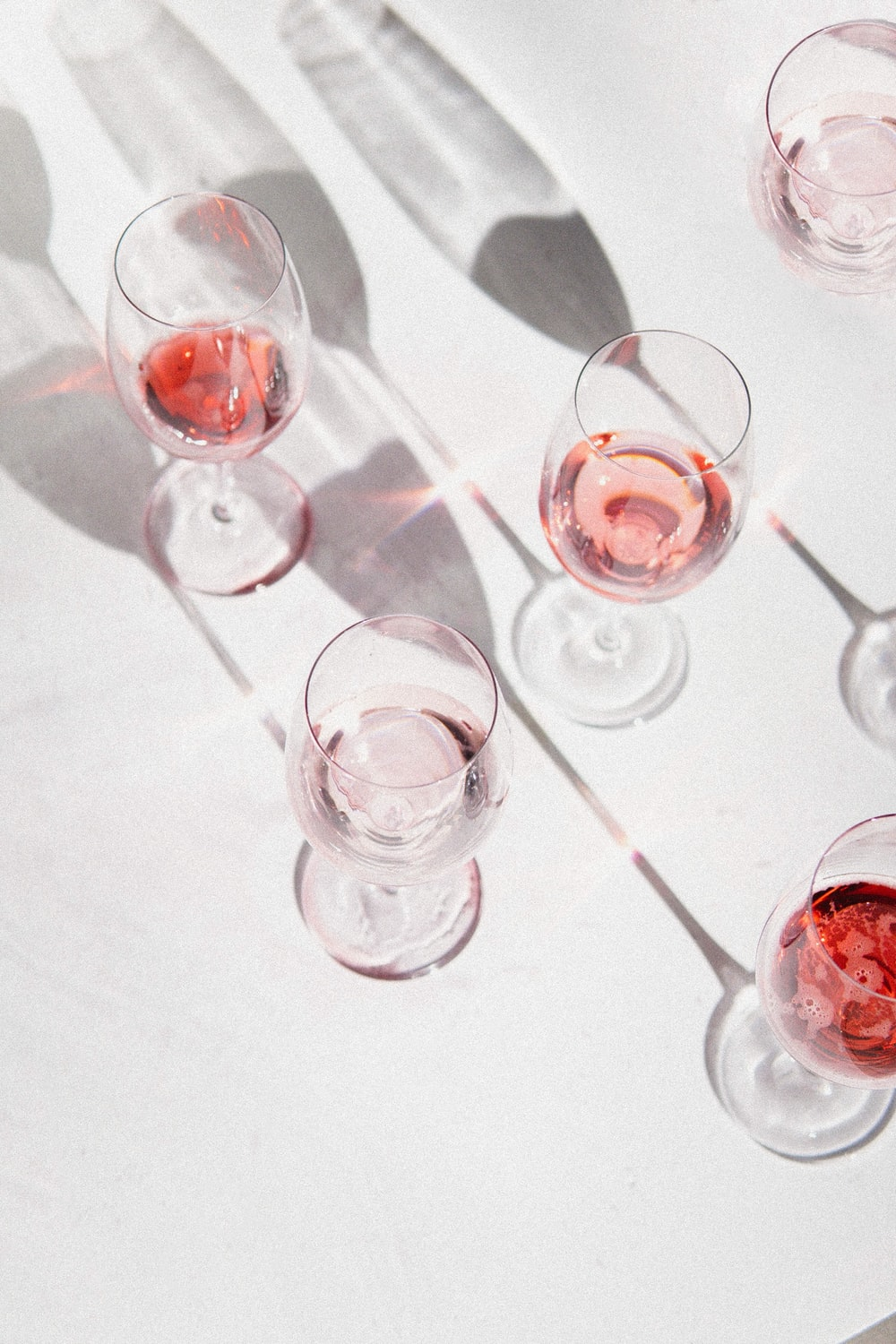 clear wine glasses on white table