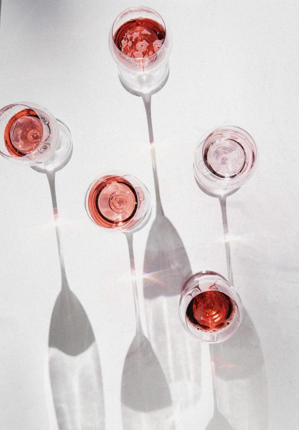 clear wine glasses with red liquid