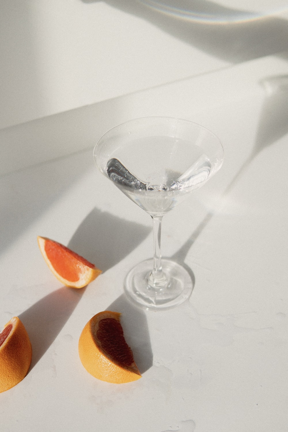 clear wine glass with sliced orange