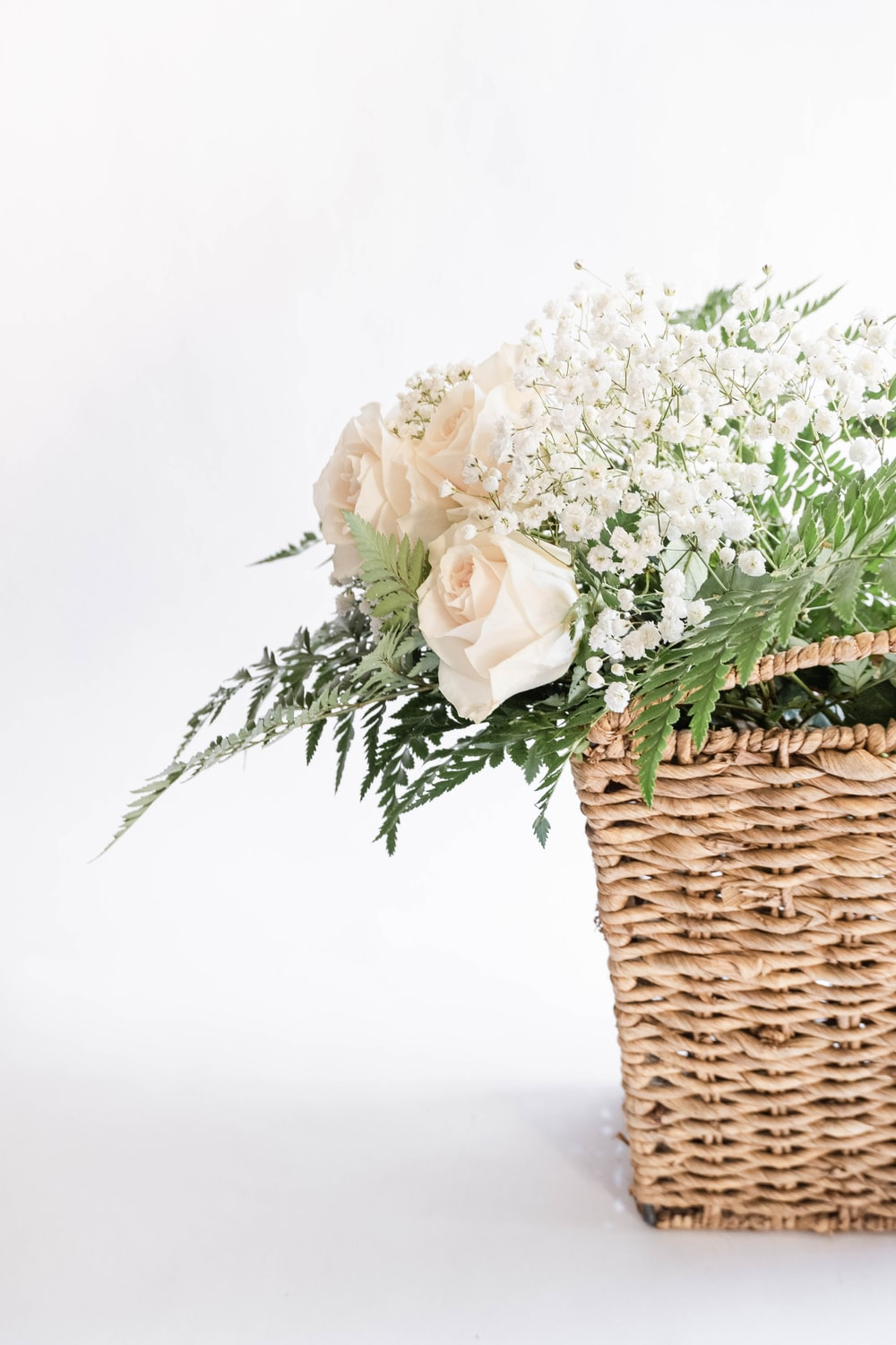 white flowers on brown woven basket