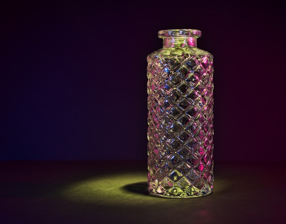 clear glass jar with purple and white light