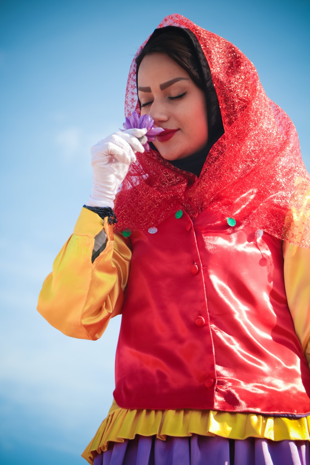 woman in red hijab and yellow jacket