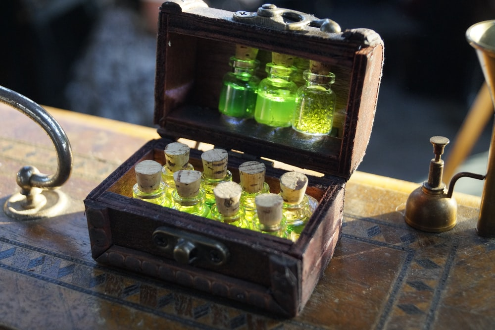 clear glass bottles in brown wooden box