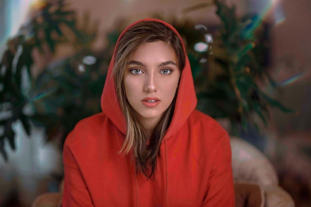 woman in red hoodie standing
