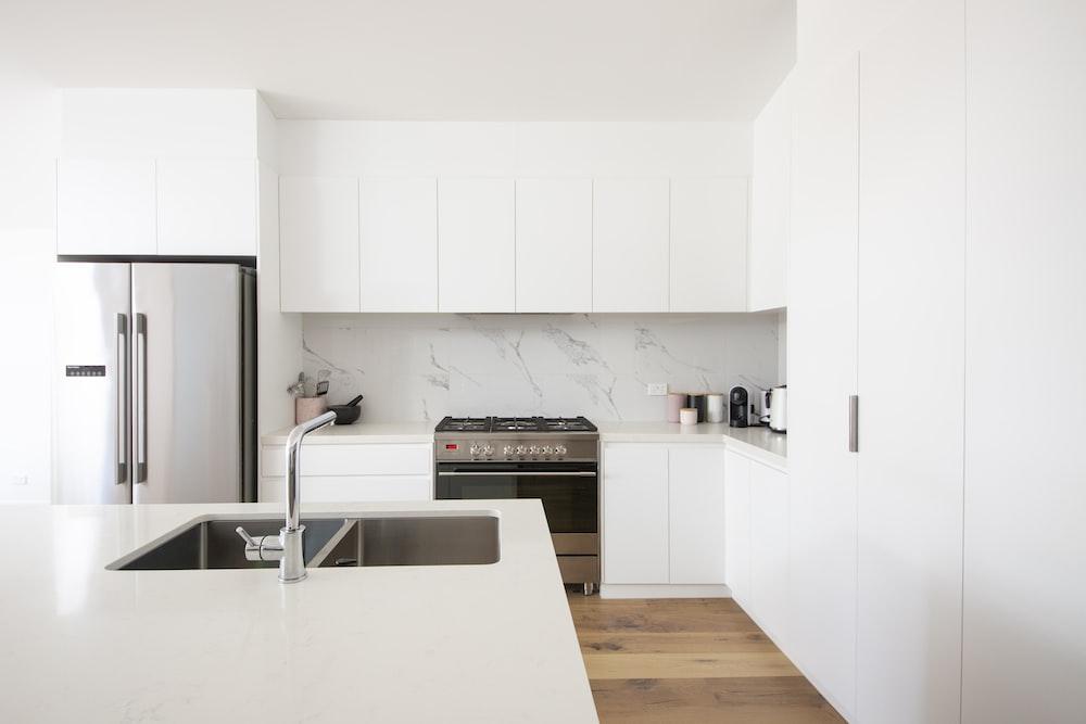 white wooden kitchen cabinet over white kitchen counter