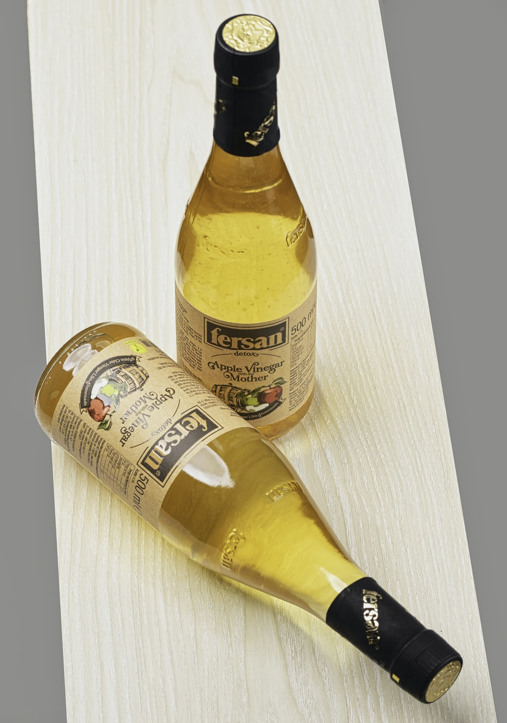 yellow and white labeled bottle