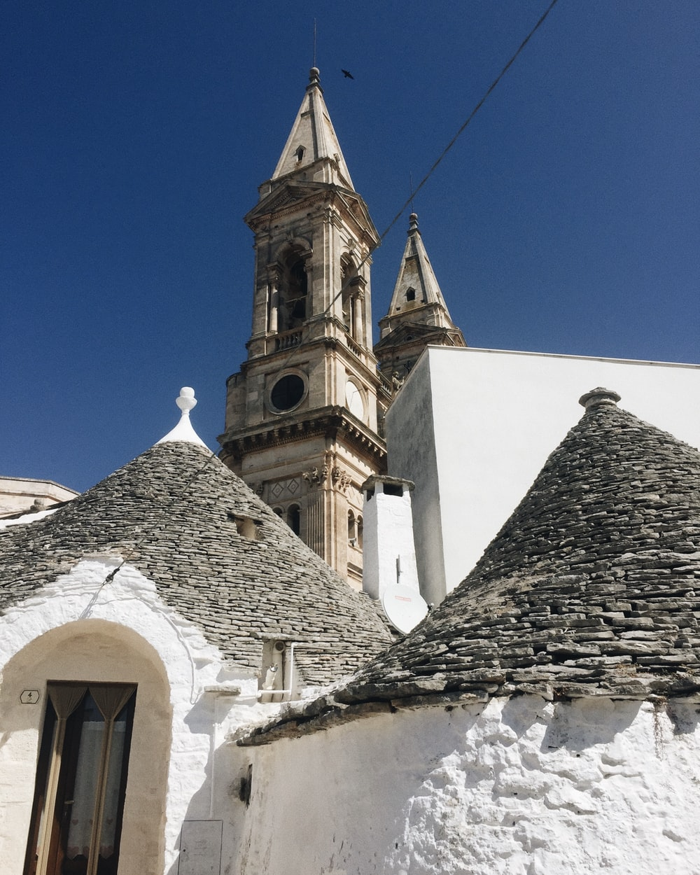 white and brown concrete church under blue sky during daytime