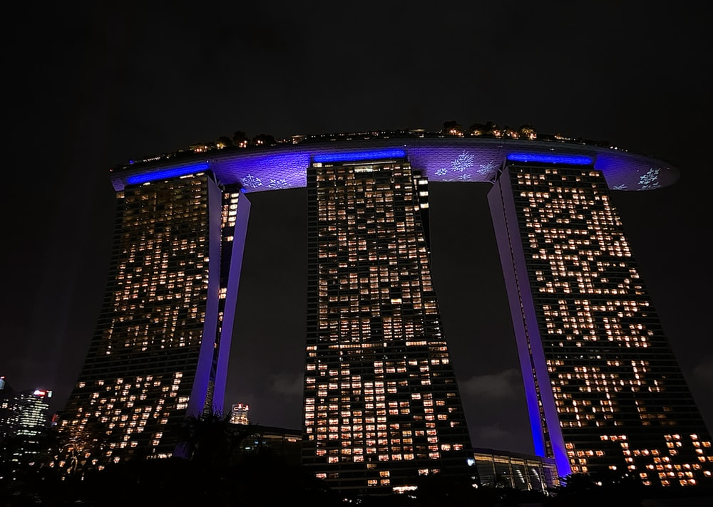 blue and black building during night time