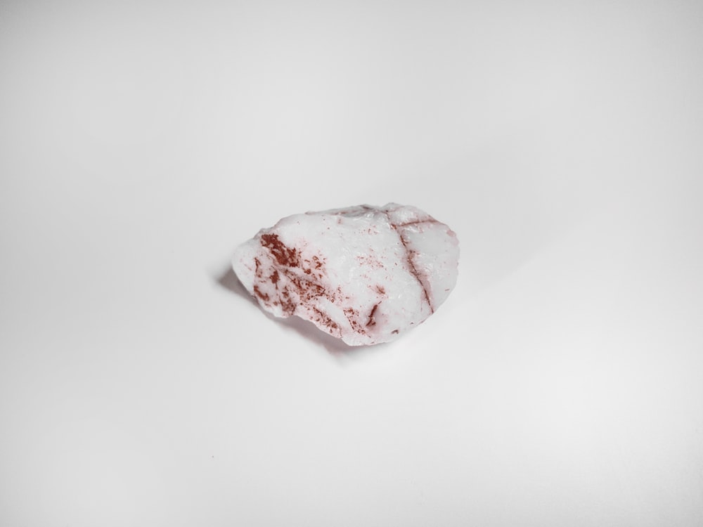 white and pink stone fragment