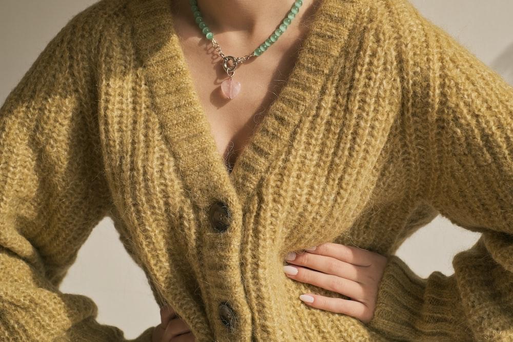 woman in yellow knit cardigan