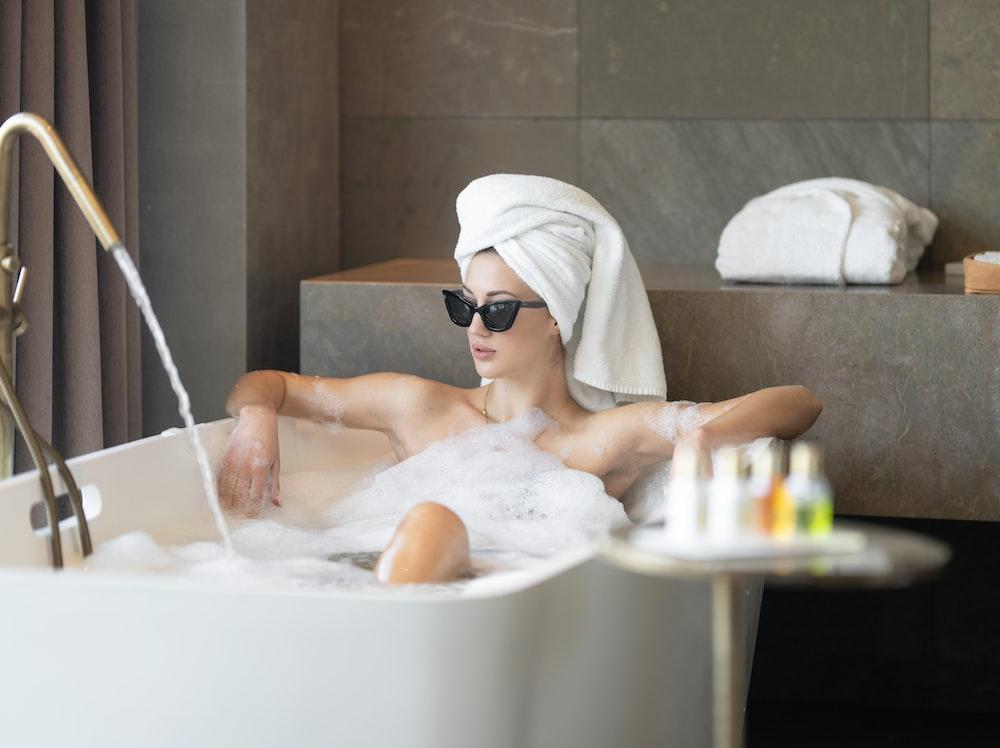 woman in white bath tub