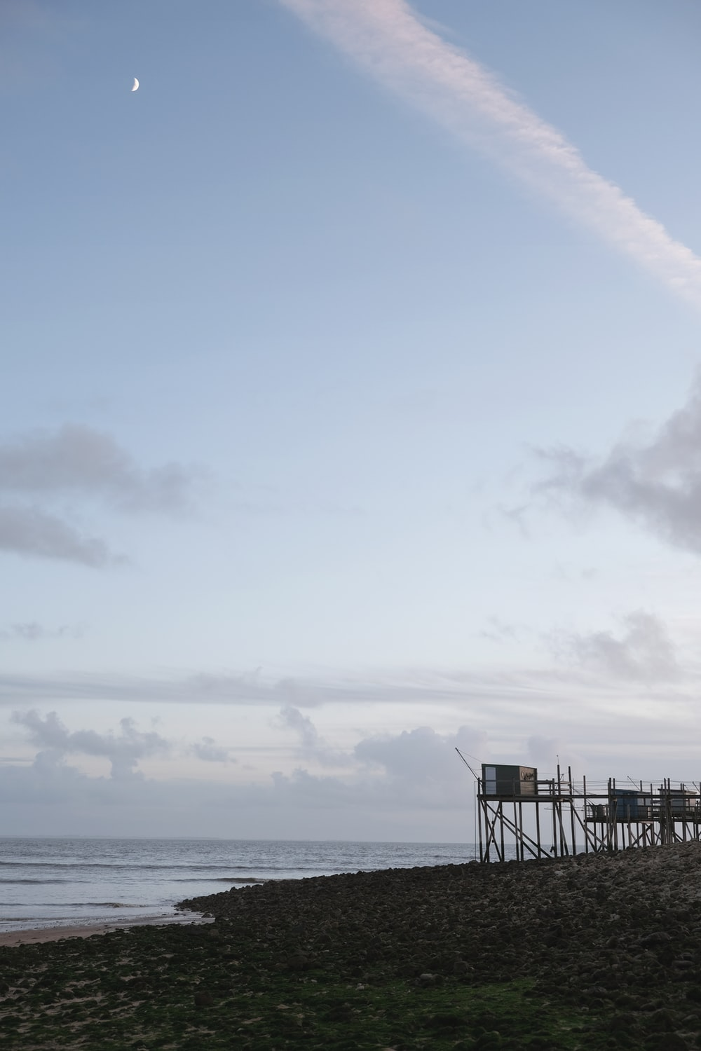 black wooden dock on sea under white clouds during daytime