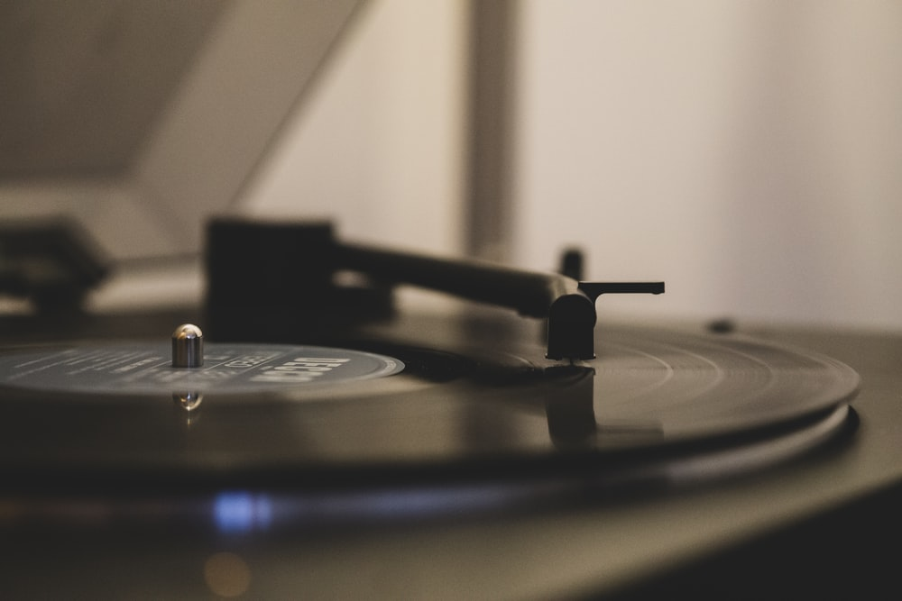 black and gray vinyl record