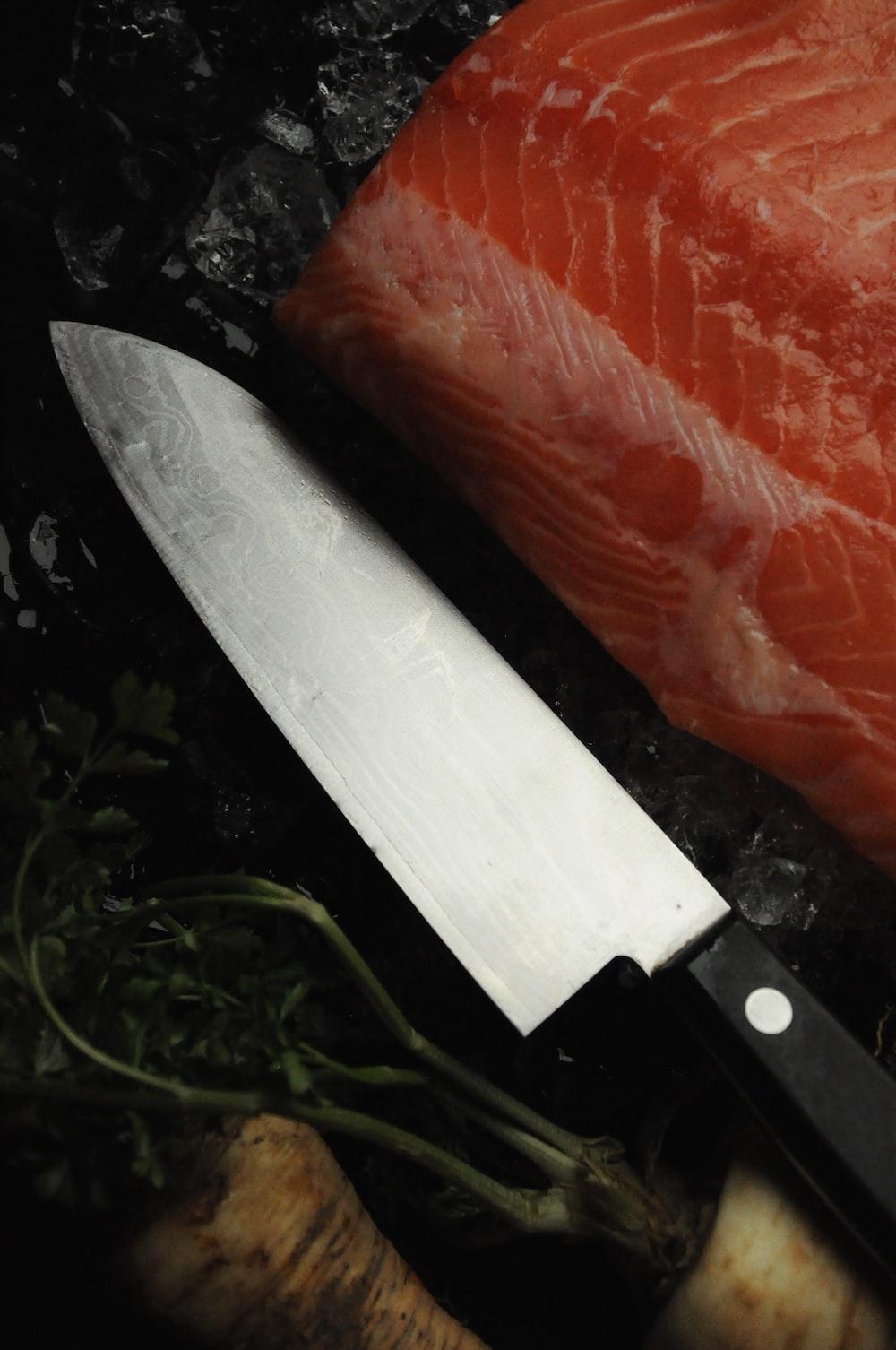 black handled knife on red textile