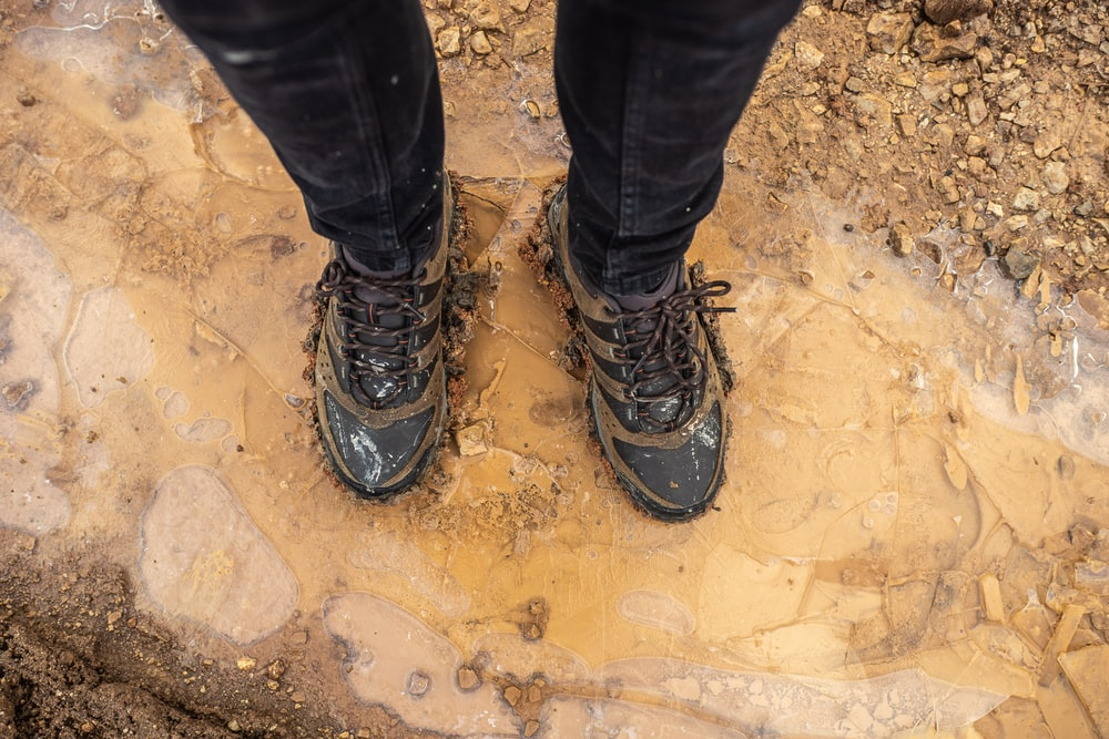 person in black pants and black hiking shoes