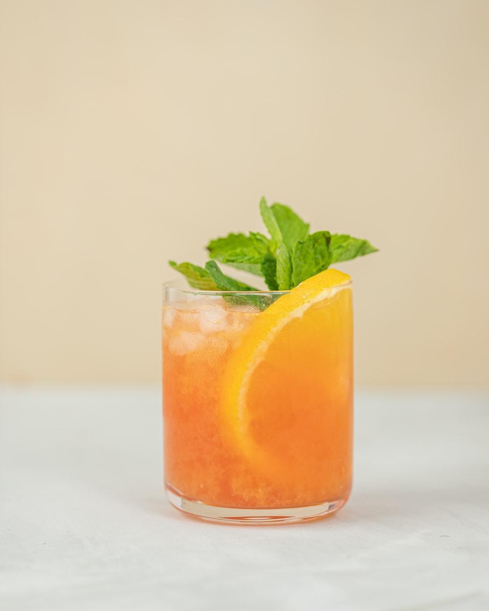 orange juice in clear drinking glass