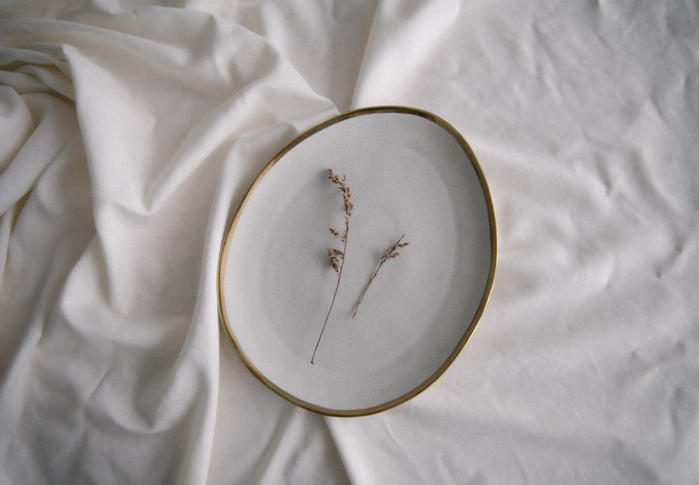 silver fork on white round plate