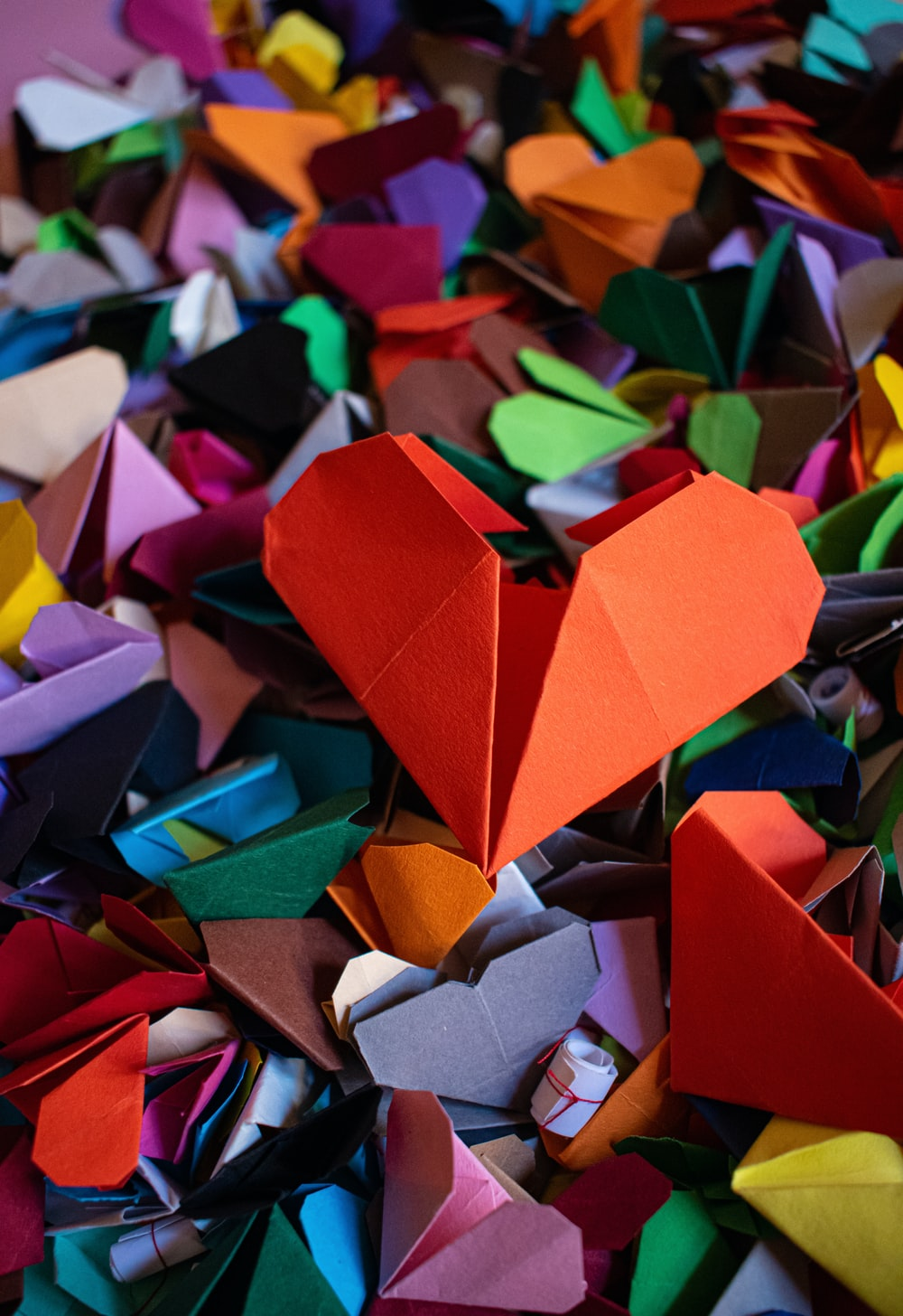 red blue green and yellow paper boats