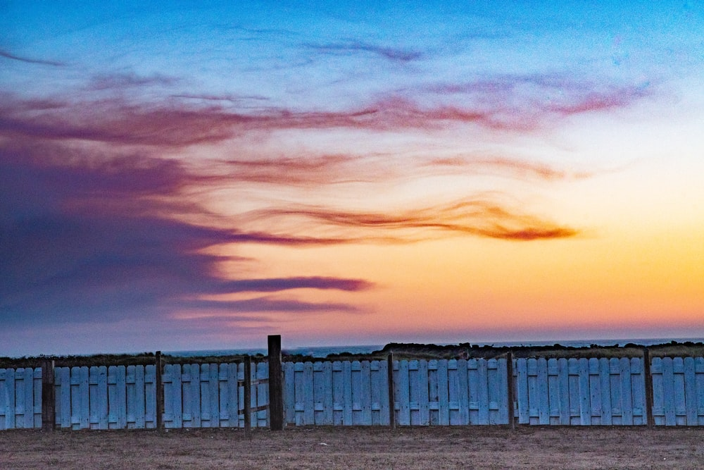 silhouette of fence during sunset