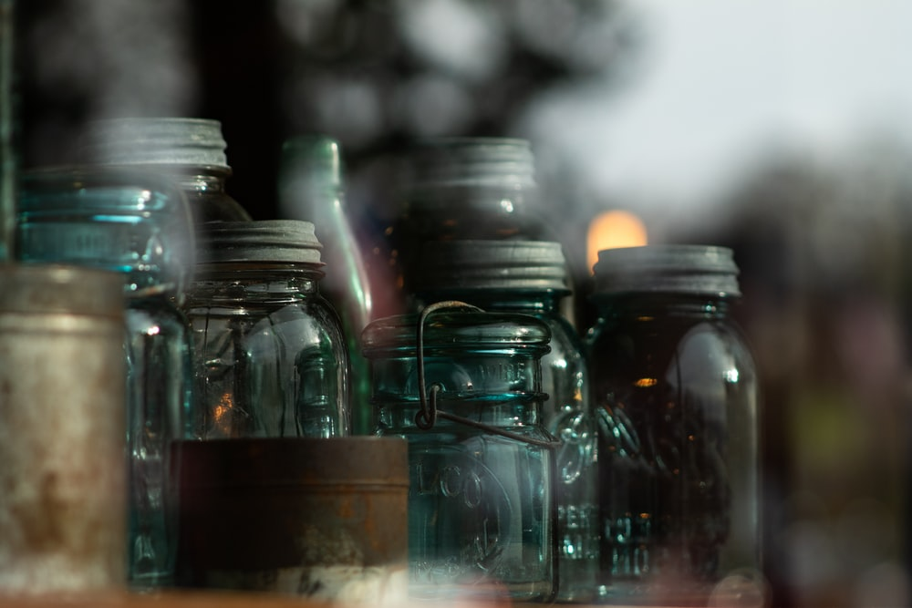 clear glass jars on brown wooden table