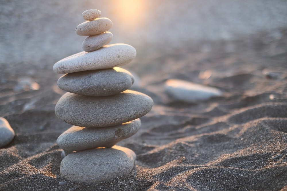 stack of stones on brown sand