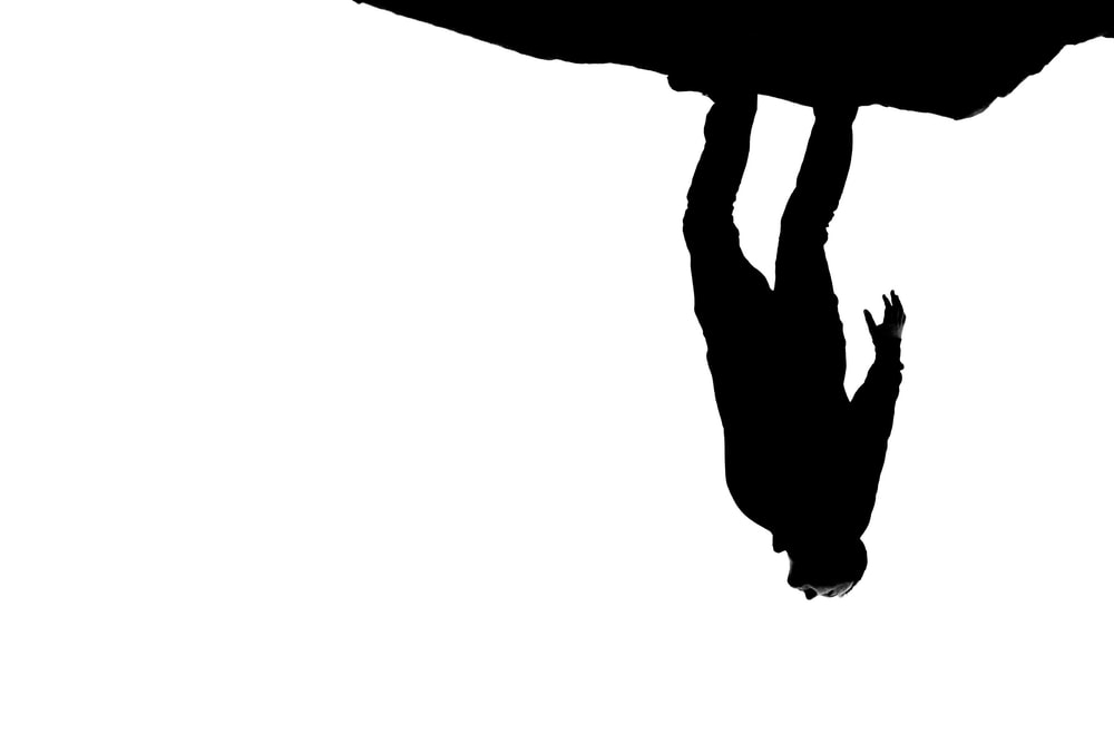 silhouette of person jumping on mid air