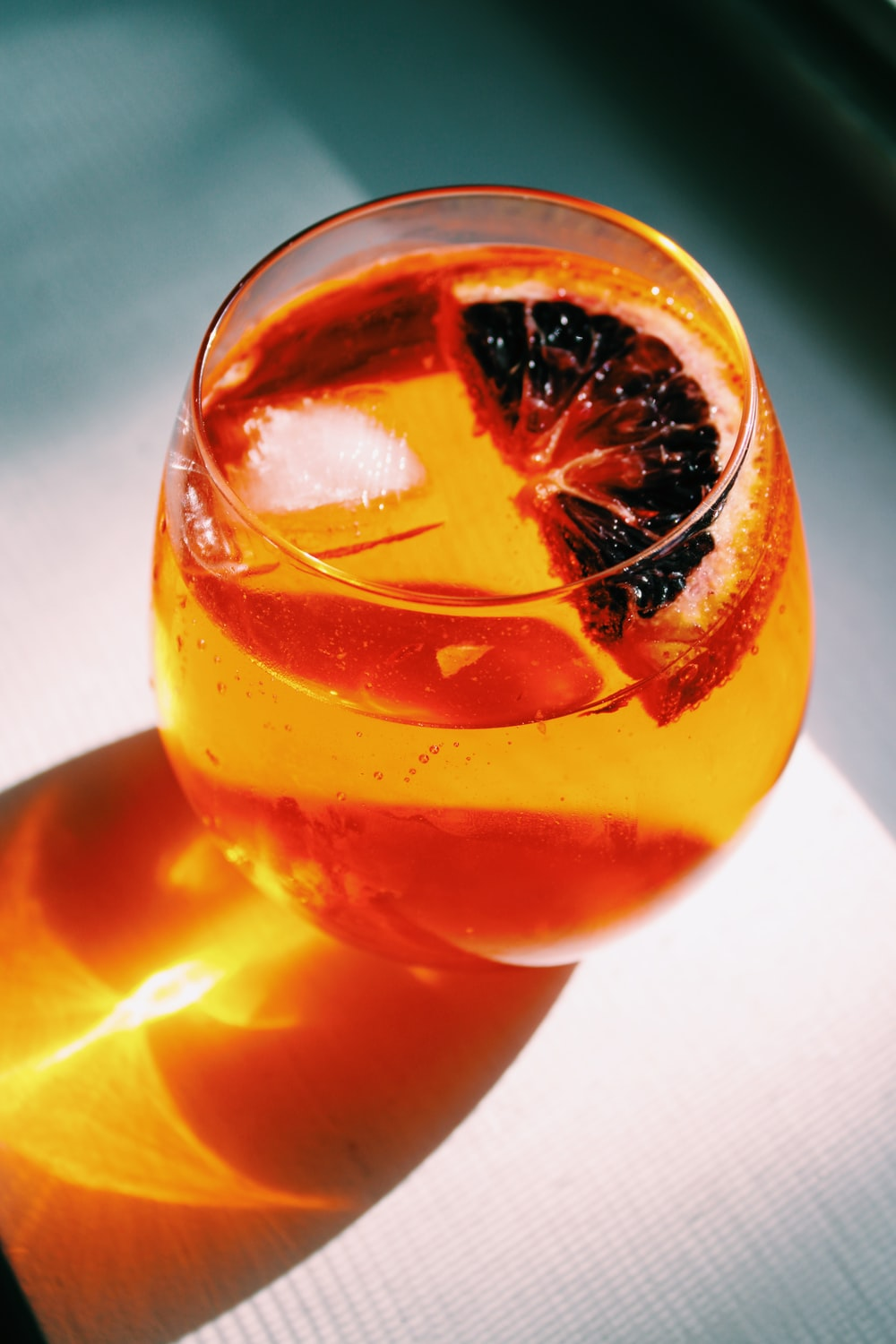 clear drinking glass with orange liquid