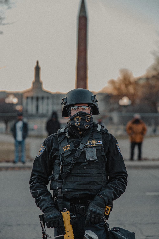 man in black jacket wearing black helmet
