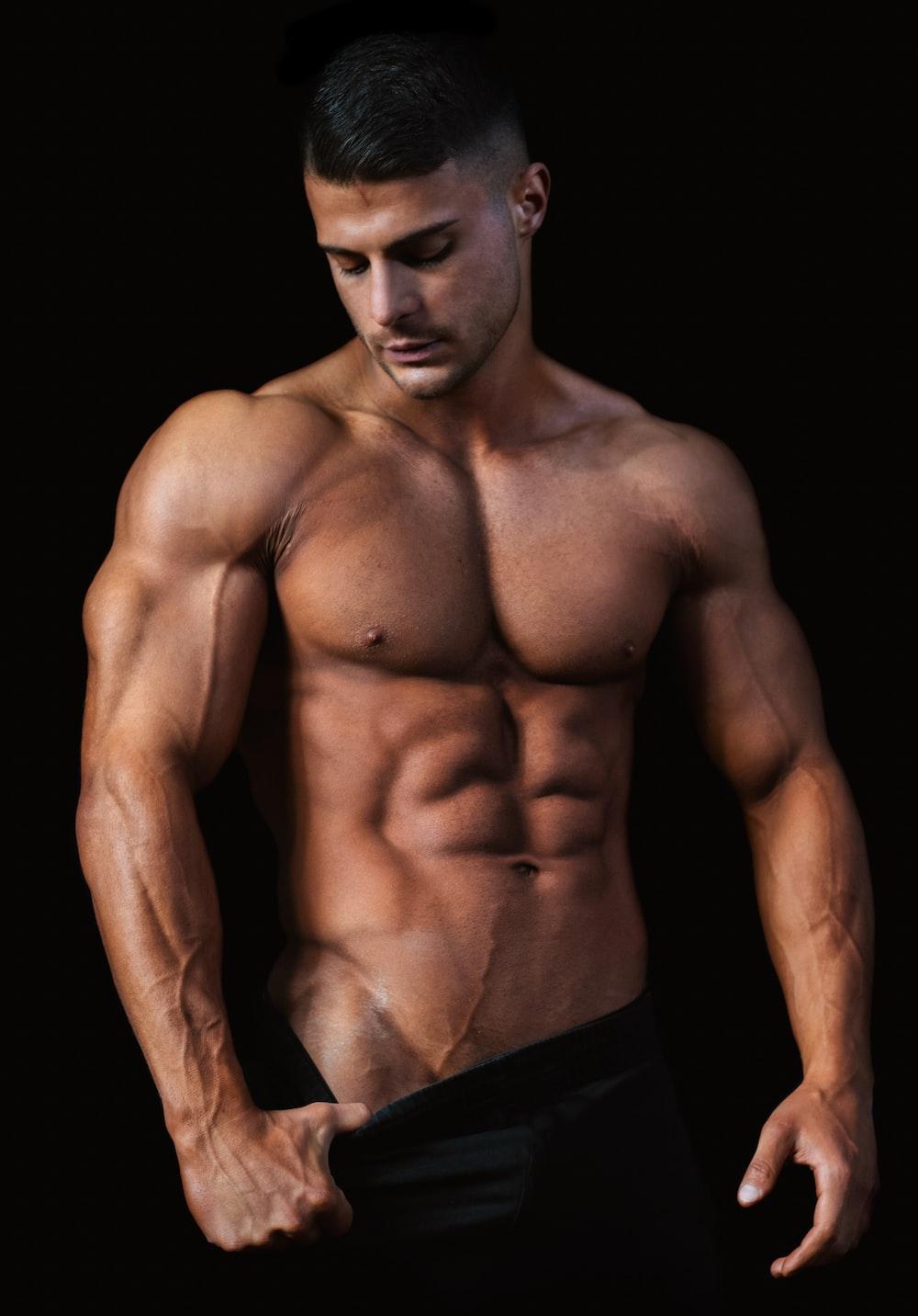 topless man wearing black pants