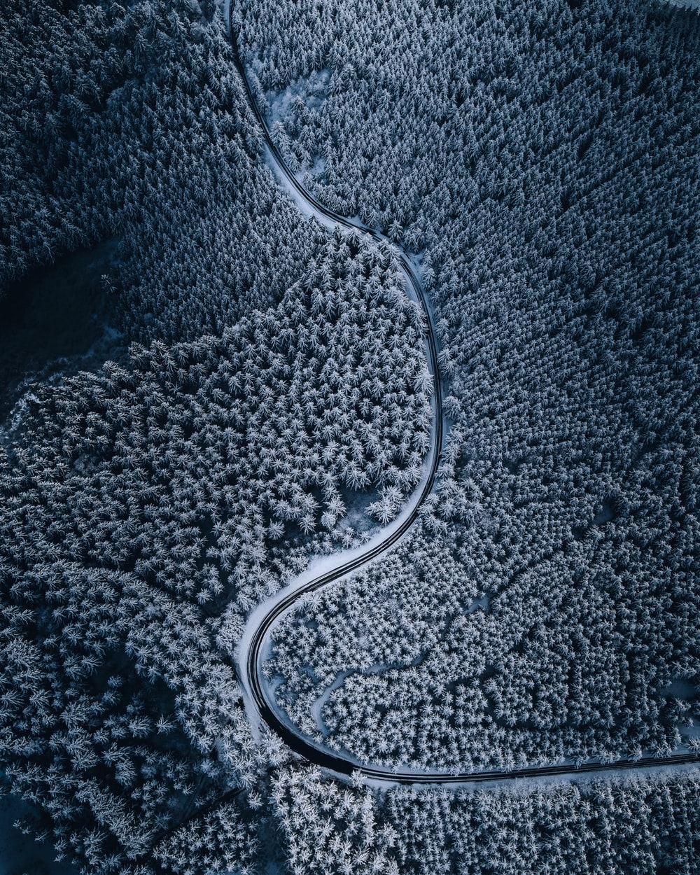 aerial view of road in the middle of snow covered ground